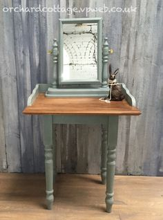 Mirror and stand, painted in ASCP Duck Egg Blue and Old White, and sealed with clear wax.