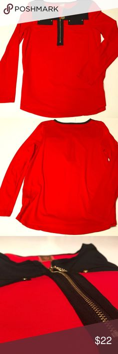 """Vintage Red and Black Zipper Anne Klein Blouse This vintage candy apple red and ebony black blouse has cute faux pockets and is uber soft. The classic Anne Klein lion insignia is on the label and functions as a neat and functional zipper  True size: Small  Dimensions while hanging: Neck: 9 3/4"""" Bust: 15"""" Waist: 19"""" Armpit to cuff: 18 1/2"""" Shoulder to hemline: 26""""  Care: Machine wash cold with like colors Dry flat May iron on low setting Anne Klein Tops"""