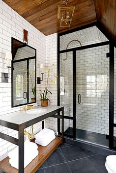 Crushing on everything about this bathroom from the subway tile, the timber ceiling, metal framed shower screen and vanity and the diagonal floor tile.