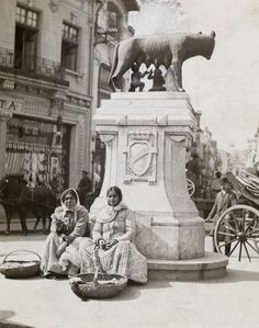 Young women sit underneath a Capitoline Wolf sculpture in Bucharest Gypsy People, Wolf Sculpture, National Geographic Images, Romanian Girls, City People, Bucharest Romania, Gypsy Life, My Town, Old City