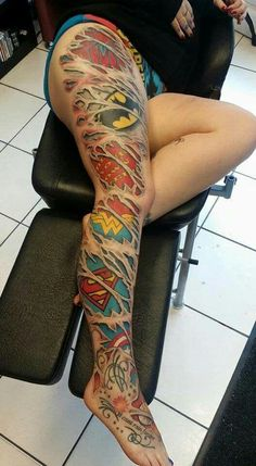 Justice League and Marvel Comics full leg tattoo.