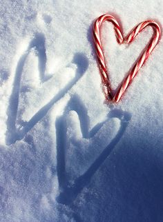 Candy cane hearts in the snow