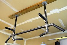 Detailed how-to for making a 4-position pull up bar at home. Would be great to go in the garage for summer workouts.: