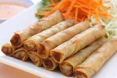 Recipe including black pepper, carrots, garlic, garlic powder, green cabbage, ground pork, lumpia wrappers, onion, salt, scallion, soy sauce, vegetable oil. Cuisine: