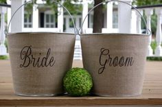 buckets to collect wedding cards- could have one bucket that says 'CARDS'