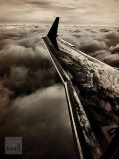 Polished wing, over turbulent Illinois skies.