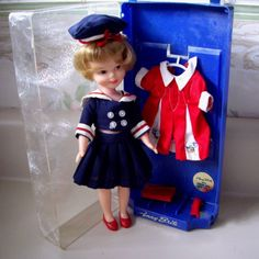 Vintage PENNY BRITE doll wearing Sailor outfit and additional red dress and doll case. 1963. $68.00, via Etsy.
