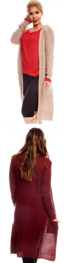 An extra long knitted cardigan is a staple for your Fall and Winter Wardrobe. The cardigan features fashionable little pockets and a cozy fit!