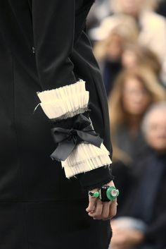 Elegant Deconstructionist Fashion - unfinished hems, pleat & bow cuff detail, emerald green jewelry // Chanel
