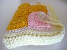 A little case made of tiny squares - about crochet.