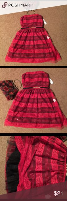 RWT Red & Black Lace Dress Size 9 NWT Pretty red lace with black lining under dress. From Top to bottom is lace accents. Tole slip under dress, adjustable belt. Size is 9 sleeveless. Please see photos for additional details. Thanks and Kind Regards  Thank you for shopping and please check out my other items. A. Byer Dresses Mini