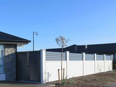Elitewall Louvre Fences are one of a range of high-quality fencing, gate and bollard products available from Boundaryline, New Zealand's fencing specialists. Social Housing, Fences, New Zealand, Garage Doors, Louvre, Gate Ideas, Garden, Outdoor Decor, Modern