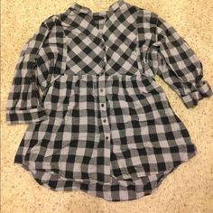ADORABLE black and gray flannel top Pre loved gray and black plaid button down front top. Ties at waist in back or front. 3/4 sleeves with buttons at the forearm. Pilling throughout. Super cute! Cut off the size tag so not sure exact size. Fits like a 2x or 1x from torrid. torrid Tops Button Down Shirts