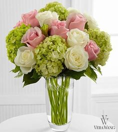 Embracing Grace Bouquet -  Capture the essence of elegance and beauty with this stunning rose and hydrangea bouquet. Pink roses, white roses and green mini hydrangea are simply brought together to create a sweet and stylish flower arrangement your Mom will love.