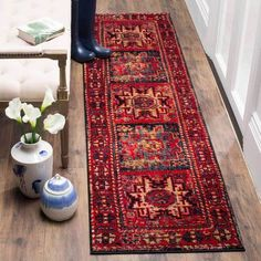 The Vintage Hamadan Rug Collection brings a refined look of antiquity to modern home decor with richly colored Persian styled carpets. Classic motifs are vividl
