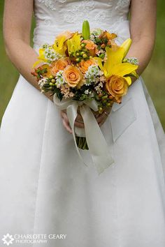 Bouquet of yellow lilies and orange roses