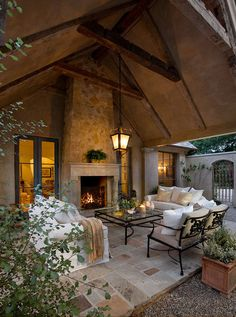 Outdoor living rooms can be used year-round when covered and paired with a fireplace. This space, much like an indoor living room, is comfortable at 16 by 16 feet and has enough room for multiple seating options and a small table.