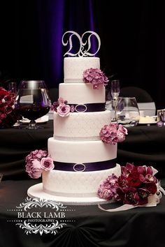 White and purple wedding cake with lots of bling.  Photo by Black Lamb Photography.