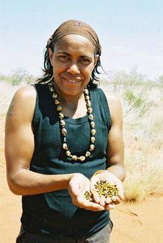 Cathy Freeman at Ali Curung (a Community near the Devil's Marbles – south of Tennant Creek) helping with the wild harvest of wattleseed. You can't get much more organic, natural and local slow food than this stuff!