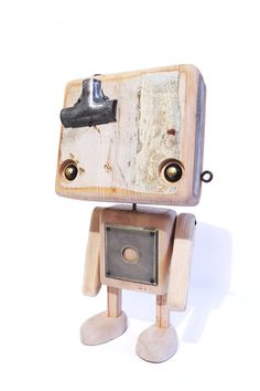 Robot made of recycled wood white head