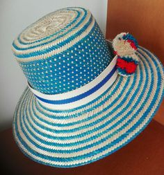 Wayuu Hat Pompons Handwoven by Wayuu Indigenous One of a kind Repeated pasterns with previous orders Info@thesuncollection.com www.thesuncollection.com