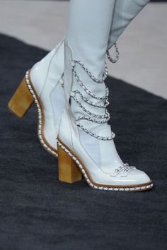 From Furry Helmuts to Globe Handbags, Let's Take a Closer Look at All the Fall 2013 Chanel Accessories: The white version of the chain link boot.