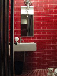 red subway tile and white grout - interesting take on exposed brick.