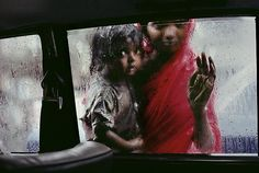 Steve McCurry, Mother and Child at Car Window, Bombay, India, 1996, C-type print on Fuji Crystal Archive paper