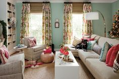 Merry and Bright - Deck the Paws - Southernliving. This dog has the most stylish seat in the house on a sprawling sectional covered in a plethora of graphic-print pillows. Here, breaking from the traditional holiday shades, the homeowner chose to decorate with other hues such as pink, sea foam green, magenta, brown, and blue to coordinate with the bold colors in the room. Neutral elements such as the rug and upholstery fabrics and even white-lacquered magnolia wreaths help ground all the…