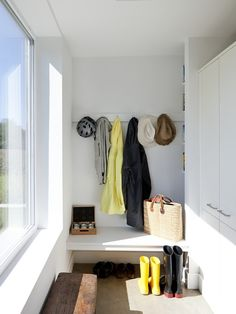 minimalist. maybe a combo of hooks on wall across from screen porch door and then shallow tall built-ins in/outside laundry door that then fits under window?