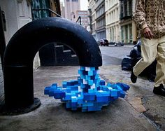 3 dimensional water flow emerging from a black faucet on Mercer Street, NYC by Pixel Pour 2.0