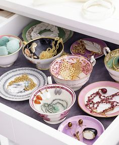 teacups as jewelry holders. adorable!
