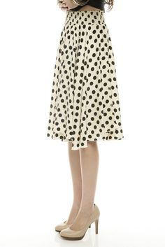 black and white polka dot circle skirt. love the graphic impact and the fun