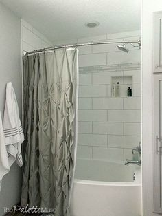 To tie it all together, we carried a strip of the marble mosaic tile into the shower as an accent, along with oversize white subway tiles. New white and gray linens from Target complete the spa feeling.