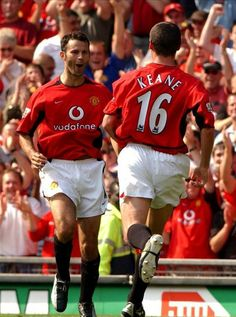Premiership - Manchester United v Bolton Wanderers - 16/8/03 Ryan Giggs  celebrates his goal against Bolton Wanderers with Roy Keane.