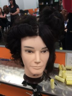 Jake pin curls out with finger wave on the right