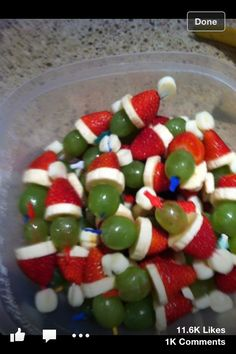 Layer mini marshmallows, strawberries, banana slice, and a grape for Grinch kabobs