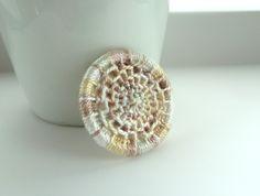 Dorset button brooch