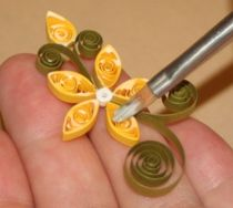 Various methods for gluing quilled pieces onto a background.