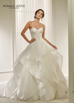 Ronald Joyce offers bridal dresses & wedding gowns with perfectly structured bodices. We craft dresses using couture techniques & quality fabrics. A Line Wedding Dress Sweetheart, Classic Wedding Dress, One Shoulder Wedding Dress, Affordable Wedding Dresses, Designer Wedding Dresses, Ronald Joyce Wedding Dresses, Bridal Gowns, Wedding Gowns, Popular Dresses