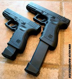 Glock 19 and its big brother the The 19 is the perfect size for balancing ease of concealed carry and controllability. Shown with magazine, shown with 33 round mag Glock Guns, Weapons Guns, Guns And Ammo, Glock 9mm, Ninja Weapons, Rifles, 9mm Pistol, Revolvers, Home Defense