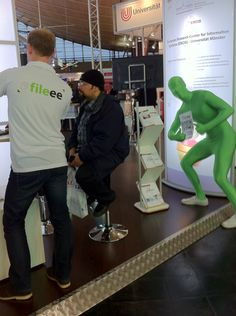 The green man photo-bombing our booth at CeBit 2012