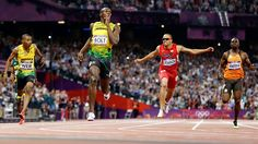 Jamaica's Usain Bolt, second left, reacts as he crosses the finish line to win the men's final at the 2012 Summer Olympics, on August (AP Photo/Anja Niedringhaus) Nbc Olympics, 2012 Summer Olympics, Olympic Records, Usain Bolt, Finals Week, Finish Line, Track And Field, Olympic Games, The Man