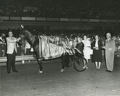 Bret Hanover in the Winners Circle at The Meadows on August 12, 1965 after pacing the mile in 1:59.4  Trainer/driver Frank Ervin in the sulky.