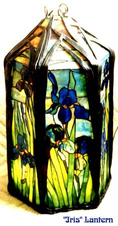 Not sure if this is an authentic Tiffany Iris Lantern; image was found on a website dedicated to creating reproductions - however, a close examination of this image suggests if it is a reproduction, it's a very good one.  Dated 2002.