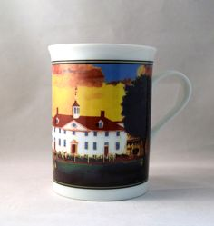 "This porcelain mug presents the west front scenic view of Mount Vernon, adapted from a 1792 painting attributed to Edward Savage. This 1792 painting also shows the courtyard of the Mansion, with George Washington and his family strolling along the bowling green. Height 4 1/2"" x 3 1/2"" diameter."