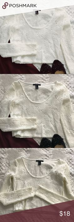 NWOT Forever 21 Long Sleeve Lace Top NWOT Forever 21 Lace Long Sleeve Top! This top is made with a thick, stretchy material and sports a cool floral pattern! It isn't see through so no need to worry if you have a problem with that! The lighting makes it look yellow but it's a mix between a white and cream color! Forever 21 Tops
