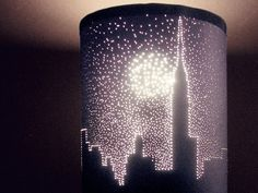With a little patience and a pin, you can make a plain black lampshade into a work of art.  Cool to make pattern or world map or elephant stencil cutouts. would make silhouettes on wall