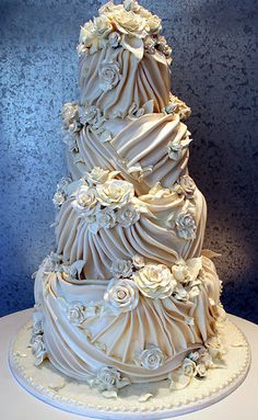 Scarlett Swans <3 Wow this cake is ruched and pleated like some of the wedding gowns that are popular. What an awesome cake.Ahhhhhhhhhh!!!