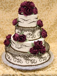 Buttercream covered with chocolate peonies. Luscious! By Konditor Meister Elegant Wedding Cakes.